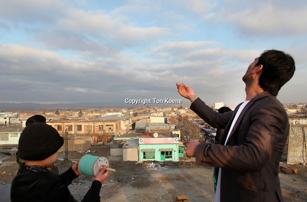 Man and boy kiting in Junduz, Afghanistan