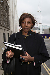 © licensed to London News Pictures. London, UK 04/10/2013. Constance Briscoe, the barrister and part-time judge who is accused of perverting the course of justice in connection with the Chris Huhne case, leaving the Old Bailey court in central London after the Plea & Case Management Hearing (PCMH). Photo credit: Tolga Akmen/LNP