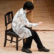 "February 18, 2012 - New York, NY : .Fuyuhiko Sasaki performs Toshi Ichiyanagi's 'Still Time II' (1986) on the kugo, an angular harp, during ""Resonances of the Kugo,"" part of the 2012 New York Music From Japan Festival, at Merkin Concert Hall on Saturday. .CREDIT: Karsten Moran for The New York Times"