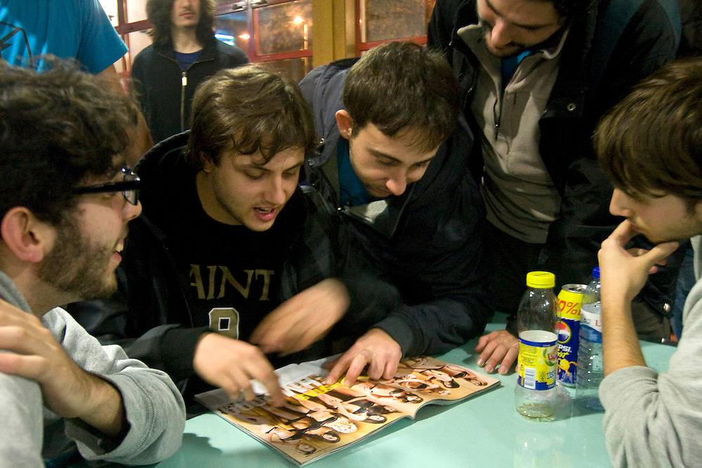 (Lisbon, Portugal - November 22, 2009) - The Galicia Black Towers flip through the latest copy of FHM at a rest stop on their way back from Lisbon. The day trip was their longest of the season, a total of 12 hours roundtrip by bus from Santiago de Compostela to Lisbon.<br /> <br /> Photo by Will Nunnally / Will Nunnally Photography