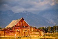 The Moulton Barn in Grand Teton National Park at sunrise with the Teton Mountains in the background.
