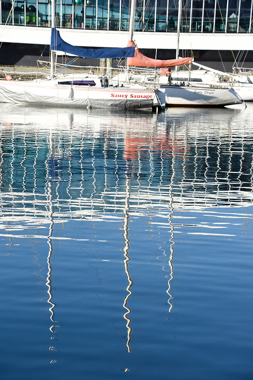 Reflections of yachts and boats in the harbour at Wellington,New Zealand