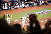 Brandon Belt (9), Pablo Sandoval (48), and the entire AT&T Park celebrate after Hunter Pence (8) hits a base hit past Cardinals' shortstop Pete Kozma (38) to bring in three runs in the third inning of the NLCS Game 7 between the San Francisco Giants and the St. Louis Cardinals on Oct. 22, 2012 in San Francisco, Calif.  The Giants would go on to win, 9-0, making their second World Series appearance in 3 years.  Photo by Stan Olszewski/SOSKIphoto.