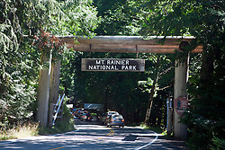 Vehicles line up to enter the Nisqually Entrance of Mt. Rainier National Park, Washington, United States of America