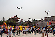 An EVA Airlines plane flies over the Bao An Temple in Taipei, Taiwan
