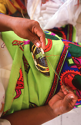 Local crafter weaving a colorful basket in Panama City, Panama, Central America.