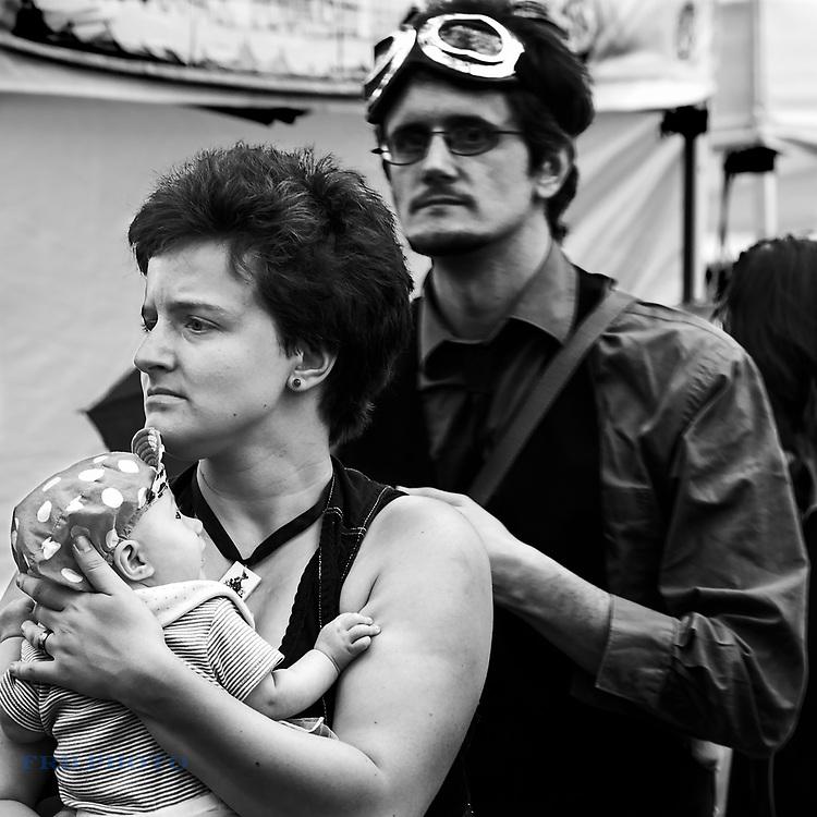 Woman, Man, and Baby at Steampunk Fair