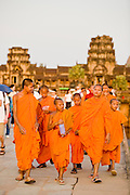 19 MARCH 2006 - SIEM REAP, SIEM REAP, CAMBODIA: Buddhist monks walk out of the main Angkor Wat complex near Siem Reap, Cambodia. Cambodian authorities estimate that more than one million tourists will visit Angkor Wat in 2006, making it the leading tourist attraction in Cambodia by a large margin. The complex is also still one of the most important centers of Buddhist worship in Cambodia.   Photo by Jack Kurtz / ZUMA Press