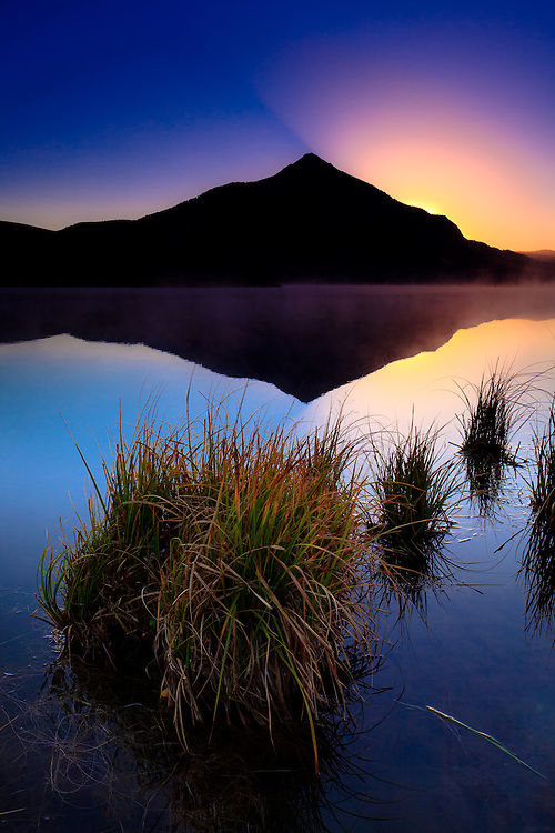 Sunrise over Mt. Crested Butte and Peanut Lake. Crested Butte, Colorado.