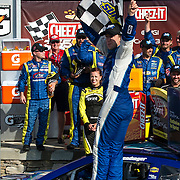 August 10, 2014:  Sprint Cup Series driver AJ Allmendinger (47) wins and celebrates with the checkered flag during the Cheez-It 355 at Watkins Glen International, Watkins Glen, NY.  Mandatory Credit: Kostas Lymperopoulos /CSM (Credit Image: © Kostas Lymperopoulos/Cal Sport Media)