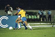 15.4.1992, Estádio Verdão, Cuaibá, Mato Grosso, Brazil.<br /> Friendly International match, Brazil v Finland.<br /> Erik Holmgren (Finland) v Bebeto (Brazil).