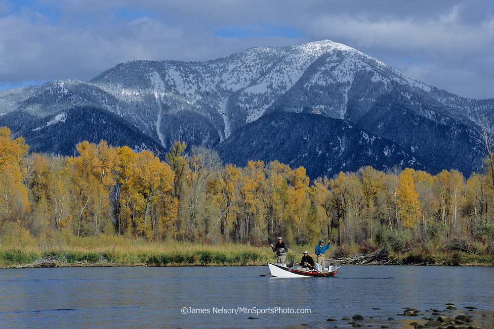 08233-D. Fishermen cast flies for trout from a drift boat during an autumn day on the upper section of the South Fork of the Snake River, Idaho.