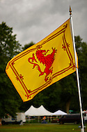 Old Westbury, New York, U.S. - August 23, 2014 - The Lion rampant flag, the royal emblem in Scotland, is one of several flags at the 54th Annual Long Island Scottish Festival and Highland Games, co-hosted by L. I. Scottish Clan MacDuff, at Old Westbury Gardens.