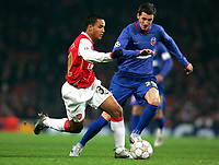Photo: Tom Dulat/Sportsbeat Images.<br /> <br /> Arsenal v Steaua Bucharest. UEFA Champions League. 12/12/2007.<br /> <br /> Florin Lovin of Steaua Bucharest and Theo Walcott of Arsenal with the ball.