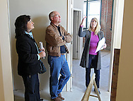 Kelly Bemus (from right) of Skogman Realty talks about various options as she shows an unfinished unit to Dennis Mochal and Barb Mochal of Olatha, Kansas at Bottleworks Loft Condominiums, 905 3rd St. SE in Cedar Rapids on Saturday, February 18, 2012. (Stephen Mally/Freelance)