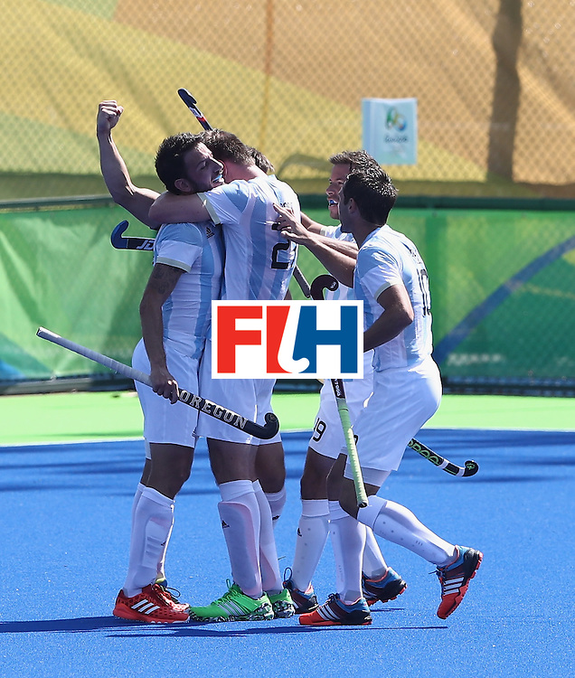 RIO DE JANEIRO, BRAZIL - AUGUST 16:   Gonzalo Peillat of Argentina is mobbed by team mates as he  celebrates after his second goal during the Men's semi final hockey match between Argentina and Germany on Day 11 of the Rio 2016 Olympic Games held at the Olympic Hockey Centre on August 16, 2016 in Rio de Janeiro, Brazil.  (Photo by David Rogers/Getty Images)