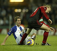 Photo: Aidan Ellis.<br /> Blackburn Rovers v Bayer Leverkusen. UEFA Cup, 2nd Leg. 22/02/2007.<br /> Rovers Morten Gamst Pedersen (L) challenges Bayer's Carsten Ramelow