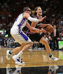 November 12, 2018 - Miami, FL, USA - The Heat's Kelly Olynnyk drives to the basket past the 76er' Mike Muscala in the first quarter as the Miami Heat host the Philadelphia 76ers on Monday, Nov. 12, 2018 at American Airlines Arena in Miami. (Credit Image: © Patrick Farrell/Miami Herald/TNS via ZUMA Wire)