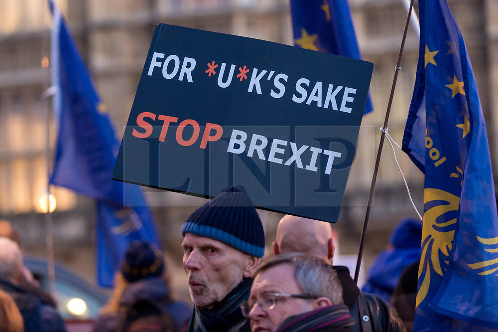 © Licensed to London News Pictures. 11/12/2018. LONDON, UK. An anti-Brexit demonstrator from SODEM (Stand Of Defiance European Movement), holds up a sign outside the House of Commons . Theresa May, Prime Minister, is touring European capitals to try to renegotiate the Brexit agreement with the European Union after today's meaningful vote by MP's was deferred.  Photo credit: Stephen Chung/LNP