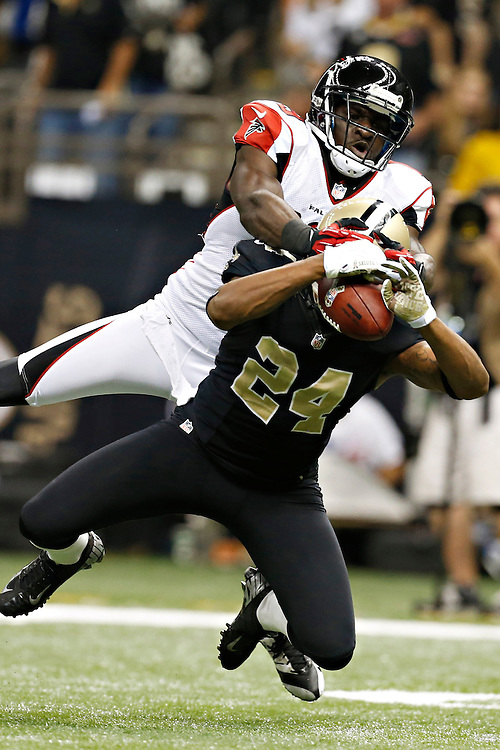 NEW ORLEANS, LA - NOVEMBER 11:  Corey White #24 of the New Orleans Saints intercepts a pass thrown to Drew Davis #19 of the Atlanta Falcons at Mercedes-Benz Superdome on November 11, 2012 in New Orleans, Louisiana.  The Saints defeated the Falcons 31-27(Photo by Wesley Hitt/Getty Images) *** Local Caption *** Corey White; Drew Davis Sports photography by Wesley Hitt photography with images from the NFL, NCAA and Arkansas Razorbacks.  Hitt photography in based in Fayetteville, Arkansas where he shoots Commercial Photography, Editorial Photography, Advertising Photography, Stock Photography and People Photography