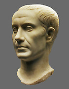 Portrait of Julius Caesar (100-44BC).  Roman, made in Italy AD40-50).  This head is made of fine Greek marble and was once part of a statue, perhaps showing Caesar in a toga.