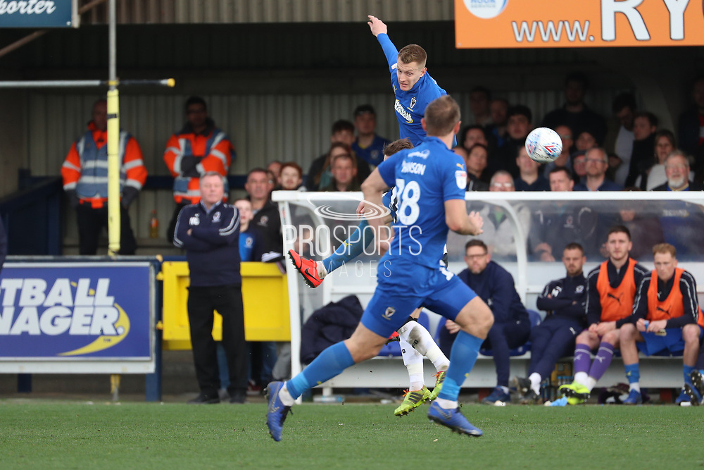 AFC Wimbledon striker Joe Pigott (39) winning header and trying to pass to AFC Wimbledon striker James Hanson (18) during the EFL Sky Bet League 1 match between AFC Wimbledon and Gillingham at the Cherry Red Records Stadium, Kingston, England on 23 March 2019.