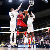 09 April 2018: Portland Trail Blazers guard CJ McCollum (3) goes for the pass while in the air between Denver Nuggets center Nikola Jokic (15) and Denver Nuggets forward Paul Millsap (4) during the Denver Nuggets 88-82 victory over the Portland Trail Blazers, at the Pepsi Center, Denver, Colorado, USA.