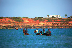 Strappers excercies horses at Gantheume Point the day before the Broome Cup.
