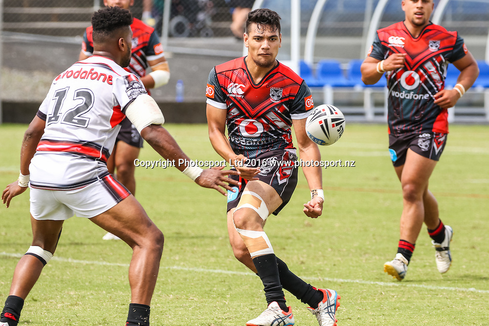 Junior Warrior's Chris Sio passes in front of NSW Cup's Joseph Prince during a pre season Rugby League match. NSW Cup v Junior Warriors, Toll Stadium, Whangarei, New Zealand. Saturday 13 February 2016. Copyright Photo: Heath Johnson / www.Photosport.nz