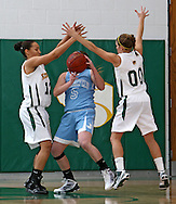 Kennedy's Jade Rogers (12) and Kristen Hahn (00) surround Jefferson's Morgan Allee (5) during their game at Kennedy High School in Cedar Rapids on Friday January 8, 2010. Kennedy defeated Jefferson 66-46. (Stephen Mally/Freelance)
