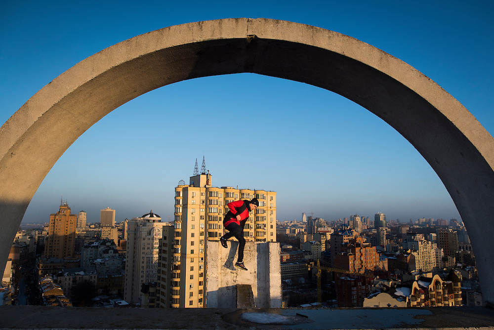 Extreme climber Mustang Wanted leaps off a ledge on the roof of a 26-storey building on February 19, 2017 in the Shevchenkovski District of Kiev, Ukraine.