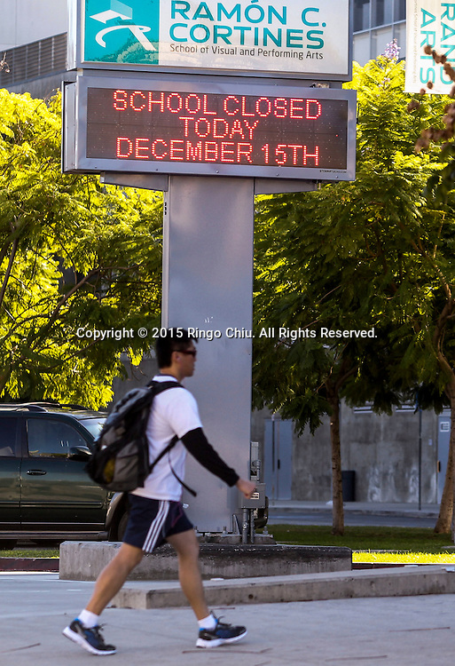 A sign shows the school is closed at the Ramon Cortines School of Visual and Performing Arts on Tuesday, December. 15, 2015 in Los Angeles. Responding to an ``electronic threat'' emailed to<br /> multiple members of the school board and campuses, all Los Angeles Unified<br /> School District campuses were closed today and a massive effort began to search<br /> the roughly 900 schools in the district.