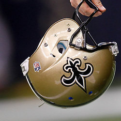 November 28, 2011; New Orleans, LA, USA; A New Orleans Saints player carries a helmet prior to kickoff of a game against the New York Giants at the Mercedes-Benz Superdome. Mandatory Credit: Derick E. Hingle-US PRESSWIRE