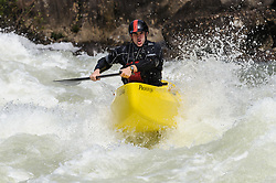 Dooley Tombras, the North American champion in open canoe slalom racing, powers his Esquif L'Edge open canoe through the rapids at Pillow Rock on the Gauley River during American Whitewater's Gauley Fest weekend. The upper Gauley, located in the Gauley River National Recreation Area is considered one of premier whitewater rivers in the country.
