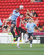 Dundee captain Kevin Thomson out jumps Sheffield United's Chris Basham - Sheffield United v Dundee, pre season friendly at Bramall Lane<br /> <br />  - &copy; David Young - www.davidyoungphoto.co.uk - email: davidyoungphoto@gmail.com