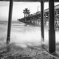 Under San Clemente pier black and white photo. San Clemente California is a popular coastal city in Orange County in the United States of America. Copyright ⓒ 2017 Paul Velgos with all rights reserved.
