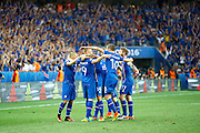 Iceland celebrate Iceland midfielder Gylfi Þór Sigurðsson's (10) goal during the Round of 16 Euro 2016 match between England and Iceland at Stade de Nice, Nice, France on 27 June 2016. Photo by Andy Walter.