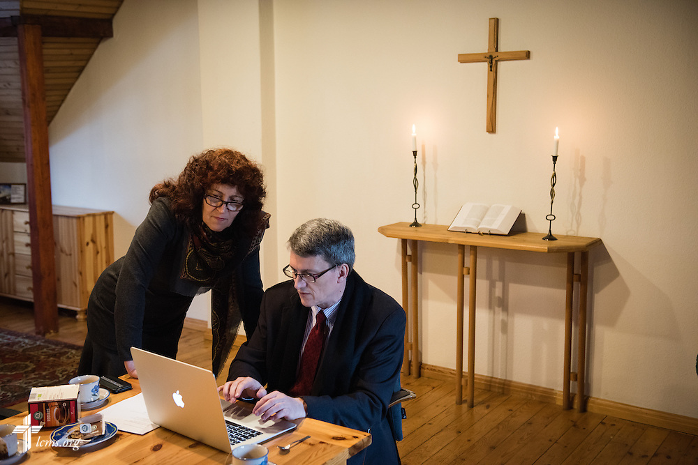 Inta Putnina, Diaconia Head of the Commission, and the Rev. Tony Booker, LCMS regional director for Eurasia, work together at the Diaconia Center head office on Wednesday, Feb. 4, 2015, in Riga, Latvia. LCMS Communications/Erik M. Lunsford