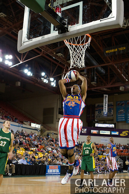 April 30th, 2010 - Anchorage, Alaska:  Harlem Globetrotter Moose (45) elevates for a dunk in the first half of the Trotters Friday night game against the Washington Generals at the Sullivan Arena.