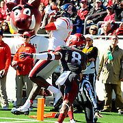 Mississippi wide receiver Vince Sanders (10) catches a touchdown pass over Arkansas cornerback Tevin Mitchel (8) during an NCAA college football game in Little Rock, Ark., Saturday, Oct. 27, 2012. (Photo/Thomas Graning)
