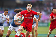 Canadian captain John Moonlight finds some space in the game Canada vs France during the Cathay Pacific/HSBC Hong Kong Sevens festival at the Hong Kong Stadium, So Kon Po, Hong Kong. on 8/04/2018. Picture by Ian  Muir.