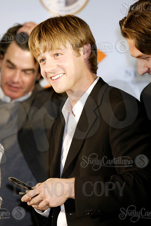 Oct 28, 2004; Newport Beach, CA, USA; Cast Member placing a fan's phone number on his cell phone BENJAMIN MCKENZIE who plays Ryan on the FOX hit TV show 'The OC' visited the Balboa Penninsula in Newport Beach to get a Key to the City and be immortalized in cement with thier hand prints to be placed at the enterance to the Historic Balboa Pavillion.  Mandatory Credit: Photo by Shelly Castellano/ZUMA Press.