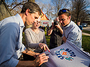 """06 APRIL 2019 - DES MOINES, IOWA: BETO O'ROURKE signs a tee shirt for RUTH THOMPSON after a campaign event in Des Moines. O'Rourke held a series of """"house parties"""" in Des Moines Saturday as a part of his 2020 campaign to be the Democratic nominee for the US Presidential election. He is crisscrossing Iowa through the weekend with stops throughout the state. Iowa holds its caucuses, considered the kickoff of the US Presidential campaign, on Feb. 3, 2020.   PHOTO BY JACK KURTZ"""
