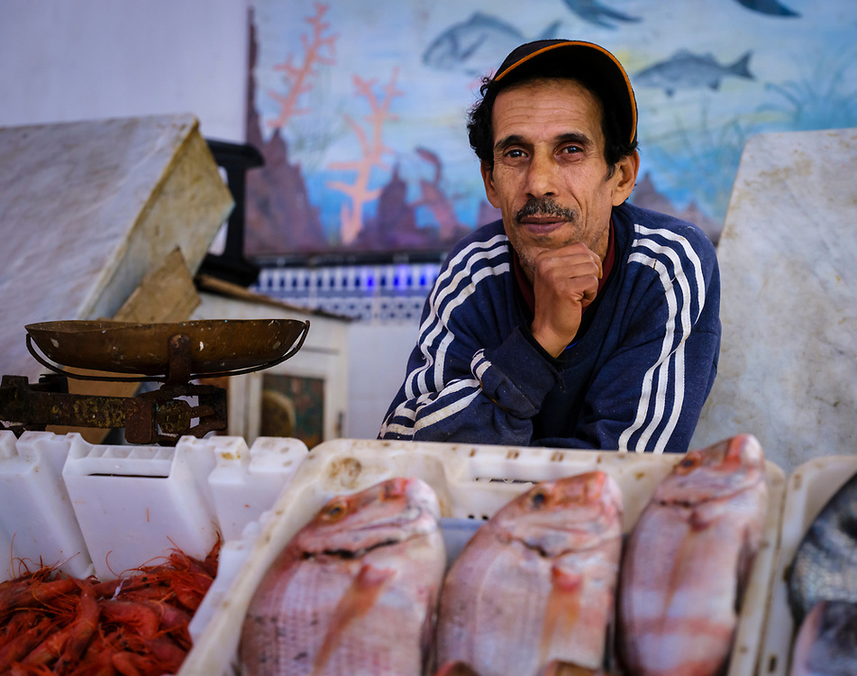 CASABLANCA, MOROCCO - CIRCA APRIL 2017: Fish seller at the fish market in Casablanca