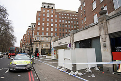 © Licensed to London News Pictures. 03/01/2019. London, UK. A police car and a cordon remain in place outside the entrance doorway to 80 Park Lane in Mayfair, where security guard Tudor Simionov was stabbed to death in the early hours of New Year's day. The 33-year-old and his colleagues were attacked by a group of men who were trying to gain entry to a party at Fountain House, a £12.5 million townhouse in London's West End.. Photo credit: Ben Cawthra/LNP