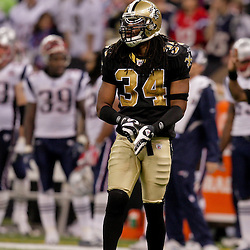 2009 November 30: New Orleans Saints cornerback Mike McKenzie (34) on the field during a 38-17 win by the New Orleans Saints over the New England Patriots at the Louisiana Superdome in New Orleans, Louisiana.