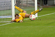 Football: Germany, 1. Bundesliga.FC Augsburg Goalkeeper Alexander Manninger gets in a tangle as he makes a save.
