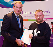 Sean Kyne TD Minister of State for Community Affairs, Natural Resources and Digital Development, presenting certification  in Employer Based Training  to  Martin Fahy QQI level 4 in IT skills  workplace safety . Photo:Andrew Downes, xposure .