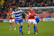 Geoff Cameron of Queens Park Rangers controls the ball from Conor Chaplin of Barnsley FC during the EFL Sky Bet Championship match between Barnsley and Queens Park Rangers at Oakwell, Barnsley, England on 14 December 2019.