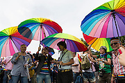 "Supporters for Taiwan's LGBT community carry rainbow umbrellas at the pride parade. The annual march through Taipei's city streets is the largest in Asia, with well over 50 000 people taking part. The 2014 event had the theme ""Walk in Queer's Shoes"", to encourage the wider community to lend their support for equal marriage rights."